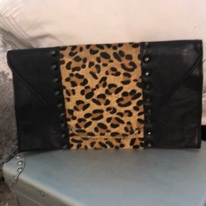 Black and leopard skin clutch with studs